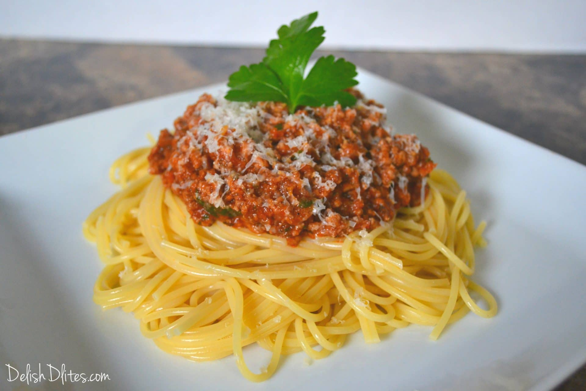 Top the cooked spaghetti with a big spoonful of this delish meat sauce ...